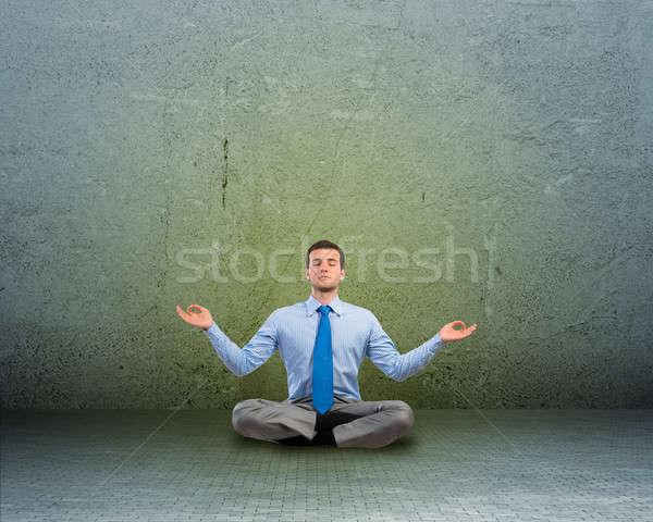 business man meditating on floor Stock photo © adam121