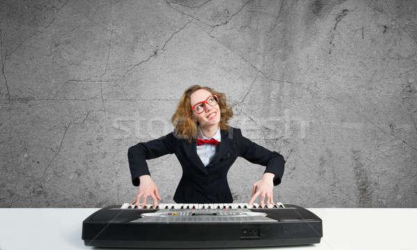 Mad woman play piano Stock photo © adam121