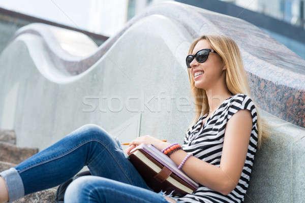 Estudante menina escada sorridente sessão Foto stock © adam121