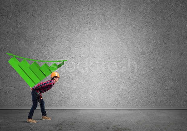 Engineer man carry progress graph stock photo © Aleksandr