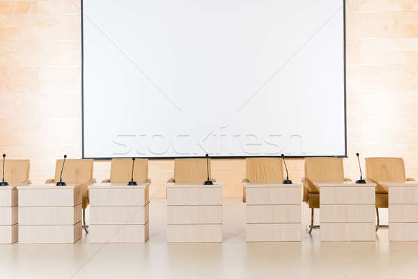 row of seats with microphones and tables Stock photo © adam121