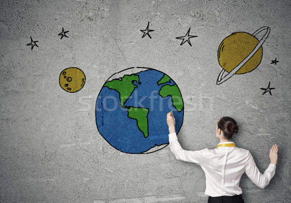Rear view of businesswoman presenting drawn planet Stock photo © adam121
