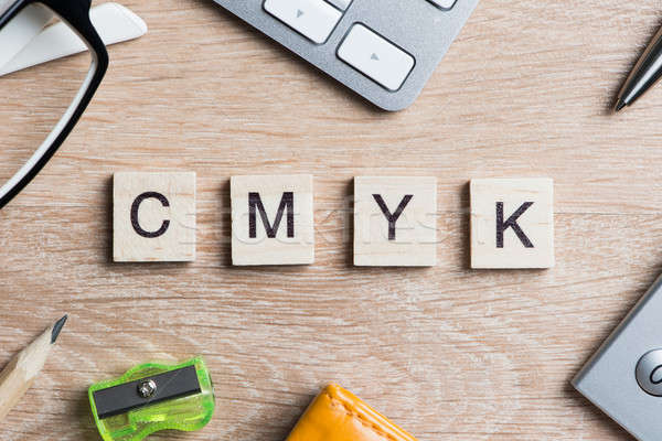 CMYK abbreviation of blocks as photography concept on business workplace Stock photo © adam121