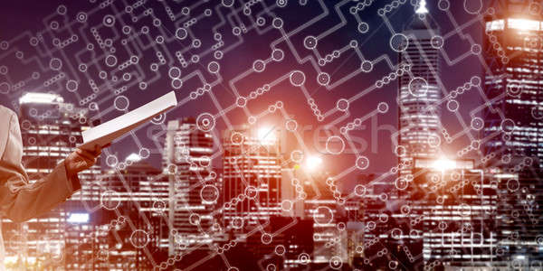 Close of businesswoman against night cityscape background and technology concept Stock photo © adam121