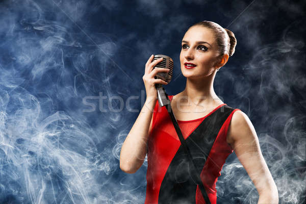 beautiful blonde woman singer with a microphone Stock photo © adam121