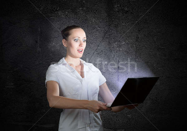 young attractive woman holding a laptop Stock photo © adam121