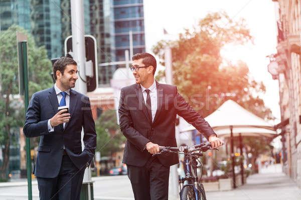 Сток-фото: два · бизнесменов · ходьбы · говорить · ходьбе · велосипед