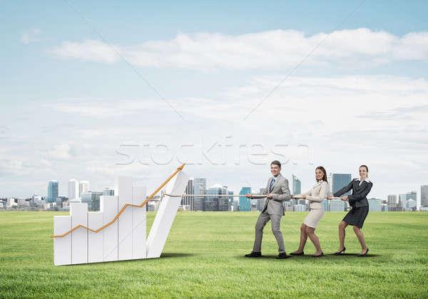 üzleti csapat dolgozik együttműködés készít diagram nő Stock fotó © adam121