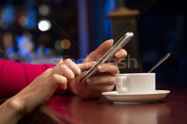 close-up of female hands holding a cell phone Stock photo © adam121