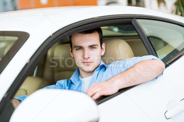Portre adam araba oturma spor araba showroom Stok fotoğraf © adam121