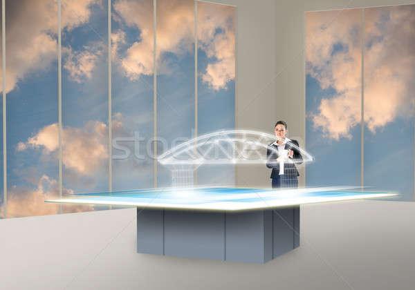 инновационный деловая женщина глядя голограмма строительство Сток-фото © adam121
