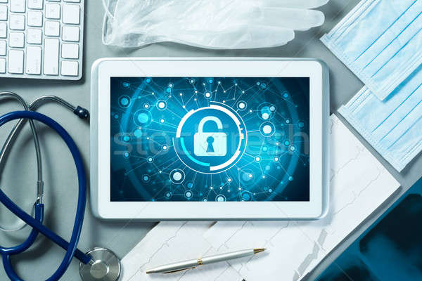 Web security and technology concept with tablet pc on table Stock photo © adam121