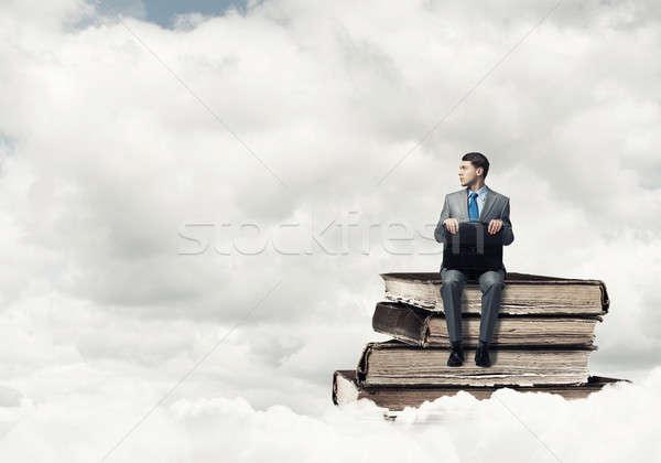 Işadamı bavul genç oturma kitaplar Stok fotoğraf © adam121