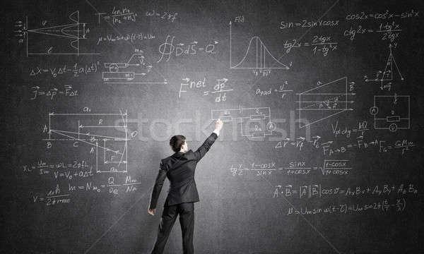 Stock photo: Man writing on blackboard