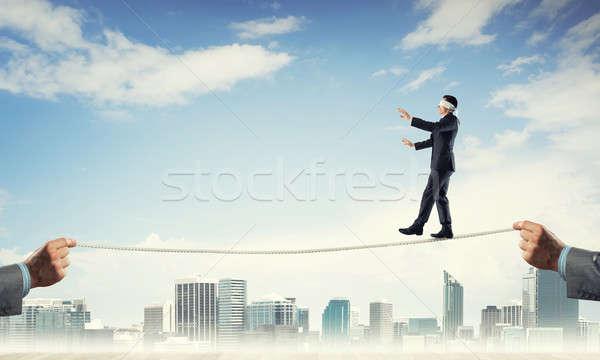 Działalności ryzyko wsparcia wsparcie człowiek biznesmen Zdjęcia stock © adam121