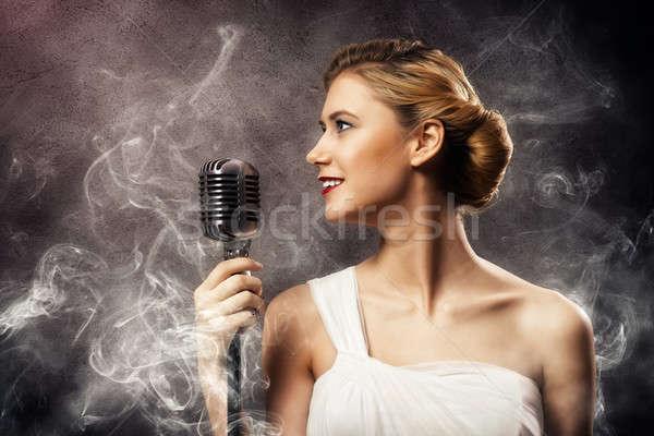 Hermosa mujer rubia cantante micrófono ojos Foto stock © adam121