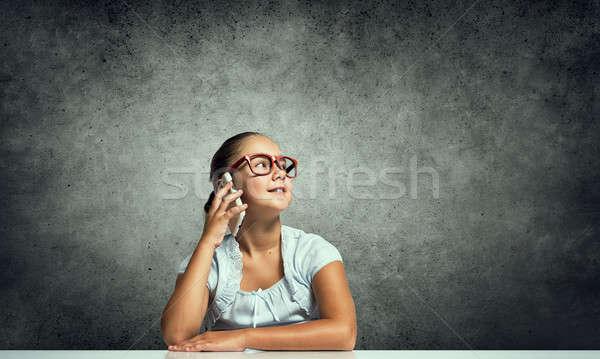 Gyerek lány mobil iskolás lány piros szemüveg Stock fotó © adam121