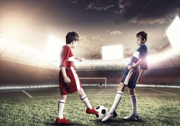 Jogo de futebol dois meninos escolas idade jogar Foto stock © adam121