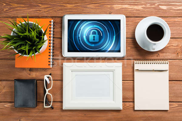 Web security and technology concept with tablet pc on wooden table Stock photo © adam121