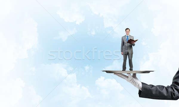 Zakenman metaal dienblad Rood boek handen Stockfoto © adam121