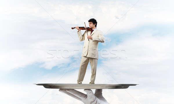 Empresário metal bandeja jogar violino blue sky Foto stock © adam121