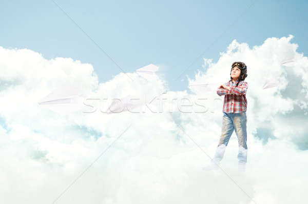 Boy in helmet pilot dreaming of becoming a pilot Stock photo © adam121