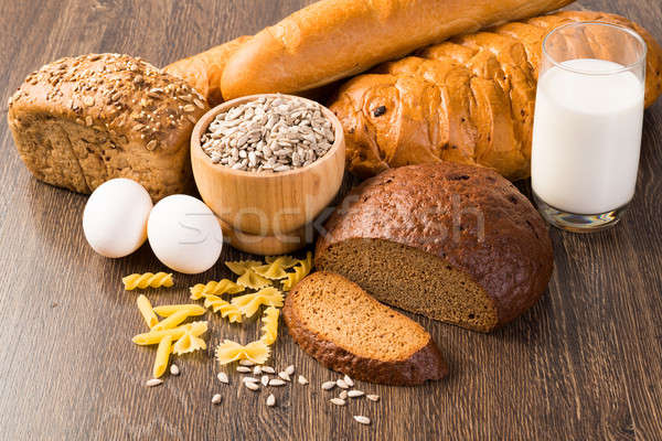 Fresh bread, eggs and glass of milk and grains. Stock photo © adam121