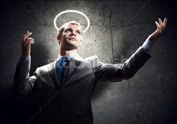 Saint affaires jeunes élégant au-dessus tête Photo stock © adam121