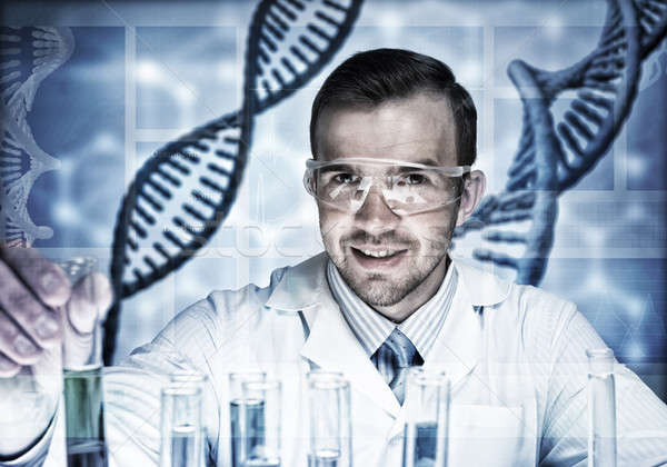 Young scientist mixing reagents in glass flask in clinical labor Stock photo © adam121