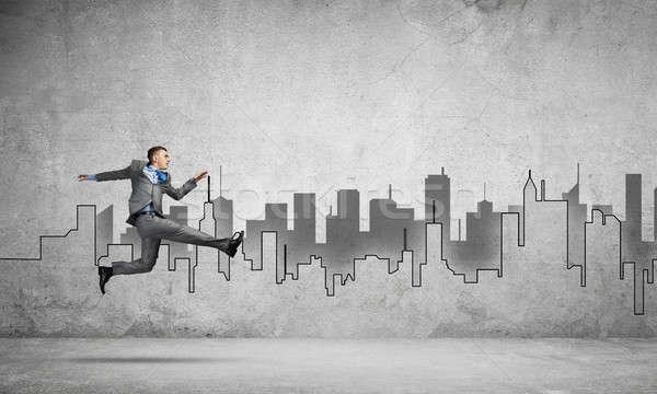 Businessman jumping high Stock photo © adam121
