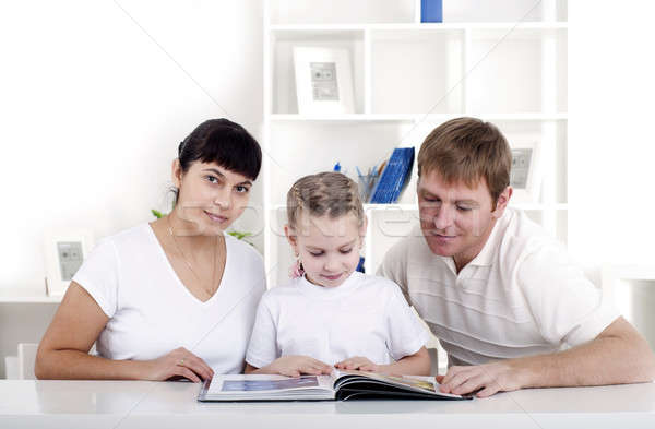 Family reading a book together Stock photo © adam121