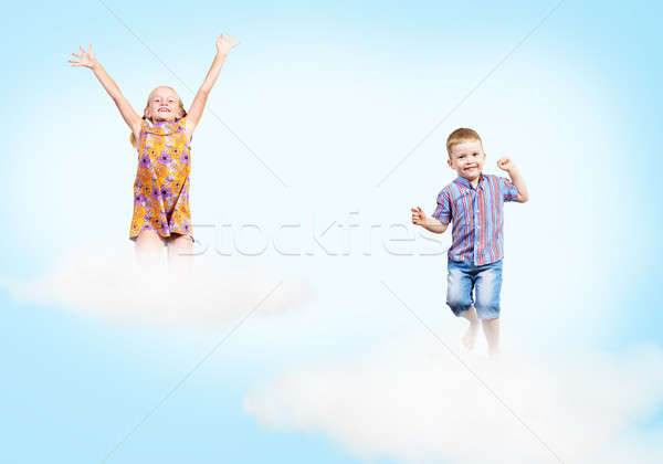 girl and boy  on clouds and a rainbow Stock photo © adam121