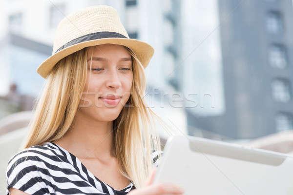 Girl using tablet pc Stock photo © adam121