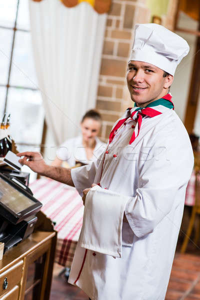 cook inserts the card into a computer terminal Stock photo © adam121