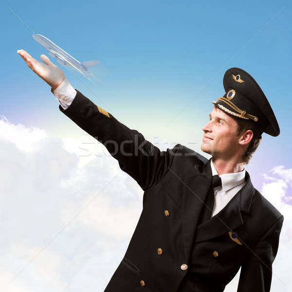 pilot in the form of extending a hand to airplane Stock photo © adam121