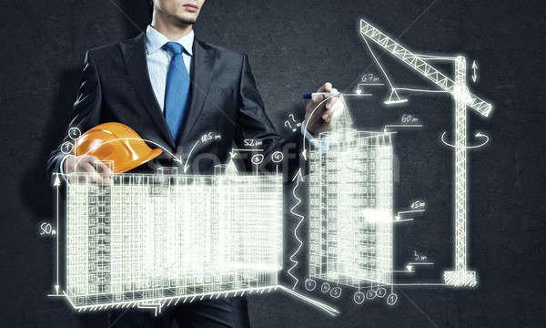 Indústria da construção moço engenheiro desenho construção projeto Foto stock © adam121