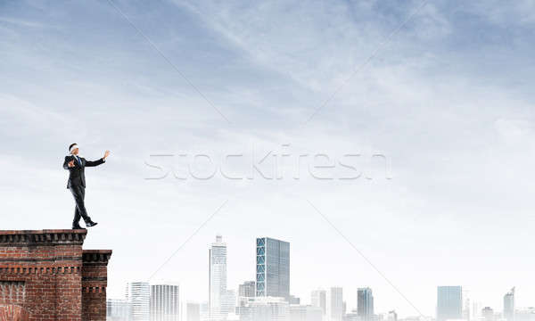 Danger and risk concept with businessman making step from edge Stock photo © adam121