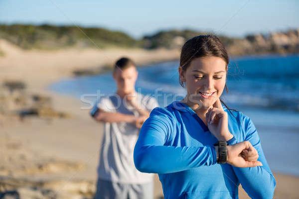 Mattina eseguire spiaggia frequenza cardiaca donna Foto d'archivio © adam121