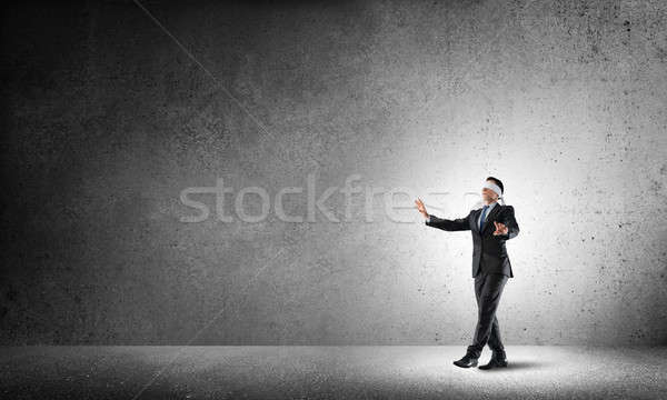Business concept of risk with businessman wearing blindfold in empty concrete room Stock photo © adam121