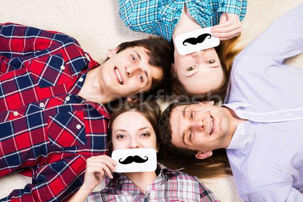 Cuatro los hombres jóvenes mentir junto cara placa Foto stock © adam121