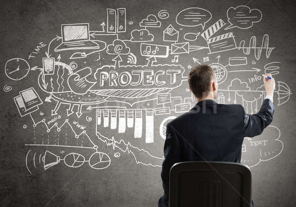 Businessman drawing business strategy Stock photo © adam121
