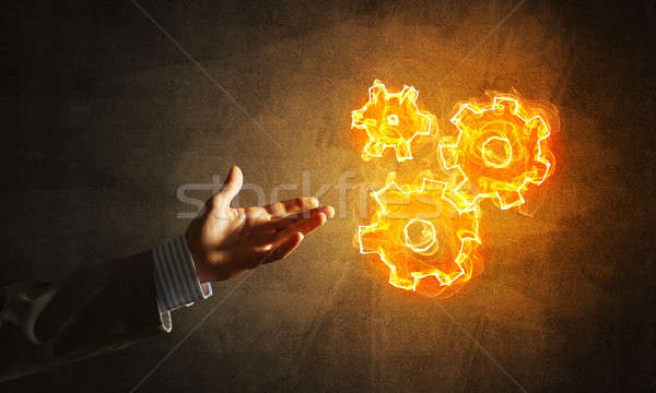 Concept of teamworking or organization presented by fire glowing cogwheels Stock photo © adam121