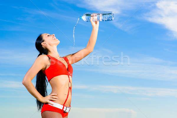Spor kız kırmızı üniforma şişe su Stok fotoğraf © adam121