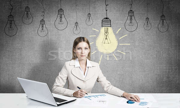 Businesswoman in process of creative work Stock photo © adam121