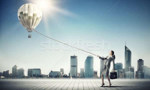 Woman catch balloon Stock photo © adam121