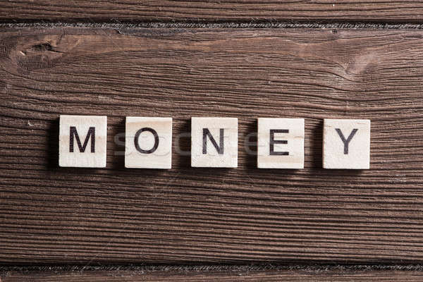 wooden elements with letter collected word money Stock photo © adam121