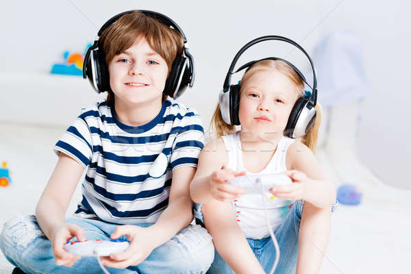 cute boy and girl playing gaming console Stock photo © adam121
