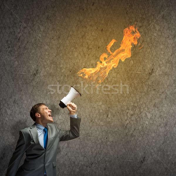 Agresywny zarządzania młodych biznesmen krzyczeć ognia Zdjęcia stock © adam121