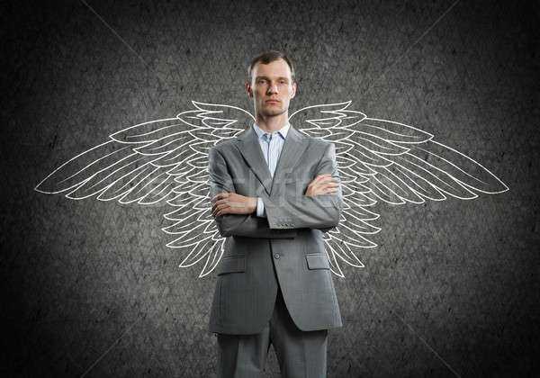 Businessman with wings Stock photo © adam121