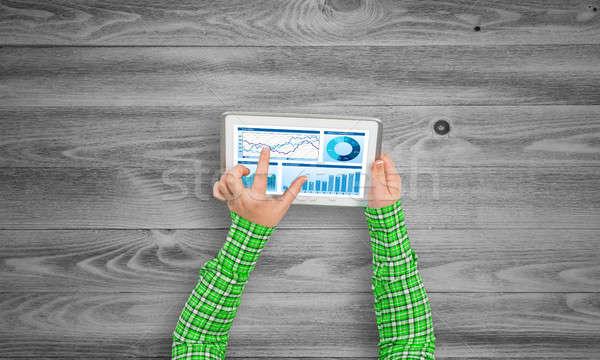 Financieros aplicación superior vista nina manos Foto stock © adam121